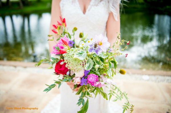 Colourful, escaping natural style bouquet for a September wedding at Wethele Manor, Warwickshire. Wildflower weddings by Tuckshop Flowers, Birmingham.