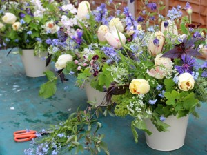 Spring flower arrangements with tulips, bluebells and trailing clematis. Event flowers and Birmingham - natural style by Tuckshop Flowers.
