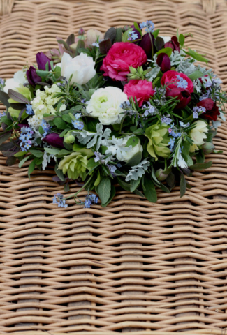 A natural, seasonal wreath of spring flowers for a funeral tribute. Birmingham. Tuckshop Flowers.