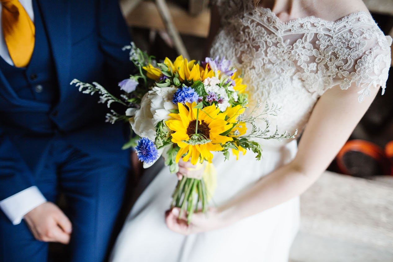 A bright and breezy sunflower wedding in Birmingham UK. Flowers by Tuckshop Flowers, photo Paul Pope