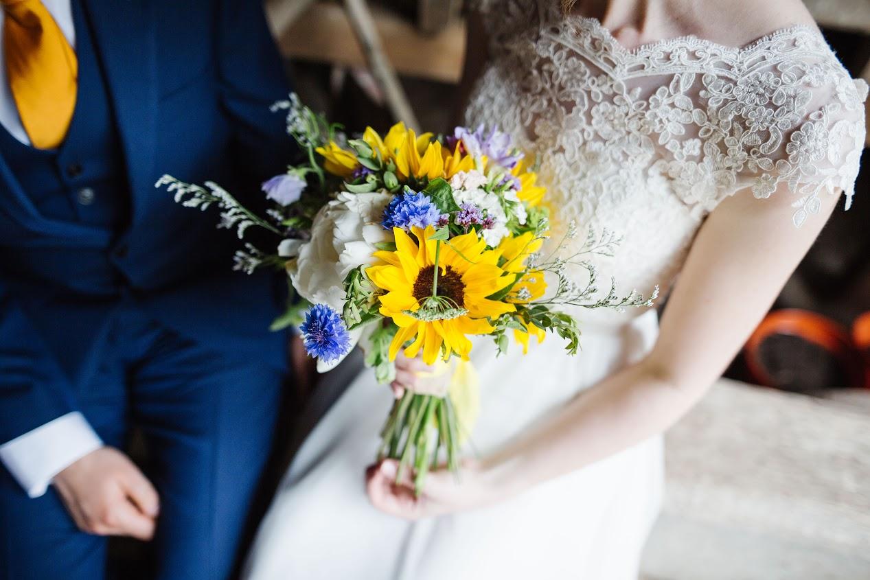 A bright and breezy sunflower wedding in Birmingham UK. Flowers by Tuckshop Flowers, photo Paul Pope