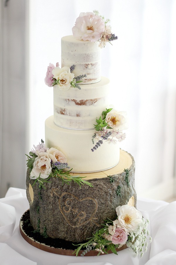 A gorgeous rustic inspired semi-naked wedding cake by the fabulous Ben the Cake Man. Rose, lavender and herb cake posies by Tuckshop Flowers, Birmingham. For Rebecca and Sam's wedding at Moxhull Hall Hotel.