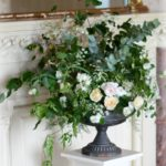 Natural escaping large flower arrangement for wedding venue. Walton Hall Hotel and Spa, Warwickshire. Wedding flowers by Tuckshop Flowers for Warwickshire, Worcestershire, Birmingham and the West Midlands