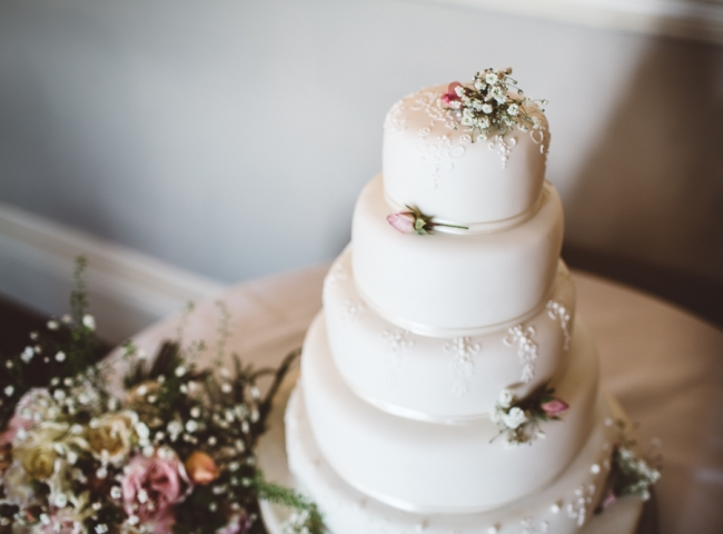 Simple wedding cake decorations. Marks and Spencers Wedding cake decorated by Tuckshop Flowers. Wedding flowers for the West Midlands, Worcestershire and Warwickshire