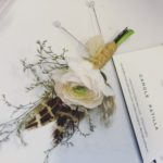 Natural wedding flowers. Wedding buttonholes with blush flowers - here a pale pink ranunculus and pheasant feathers. Tuckshop Flowers, Birmingham