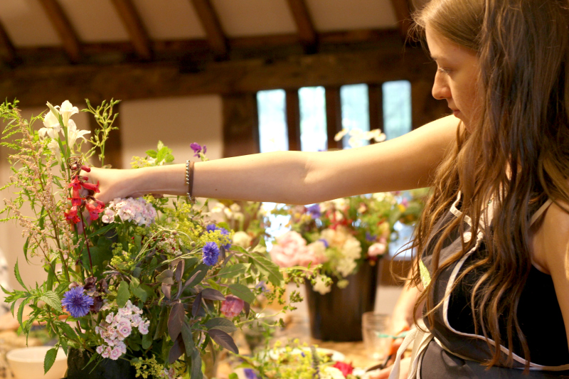 Wedding flower workshop - Lizzie concentrates on making up an arrangmement to decorate a beam at my recent wedding flowers workshop at St Nicolas Place, Birmingham