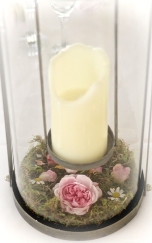 moss and flower detail in base of lantern wedding table centrepieces