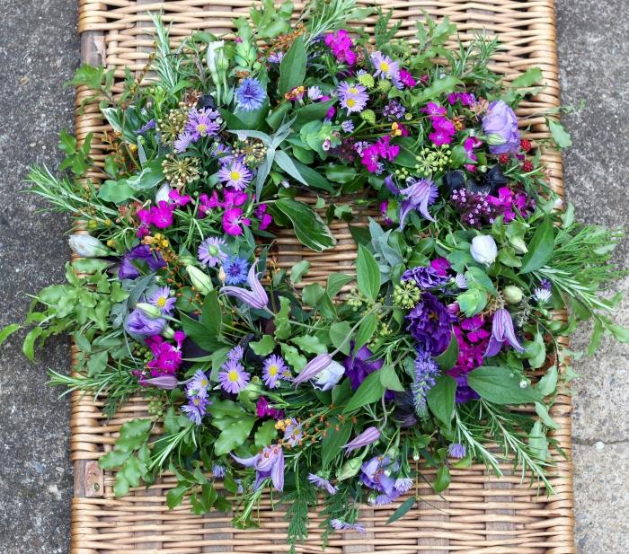 Natural purple wildflower style funeral wreath by Tuckshop Flowers, Birmingham