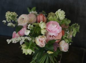 Seasonal spring wedding bouquet with ranunculus and other seasonal British flowers. Tuckshop Flowers, Birmingham specialises in British flowers arranged in a relaxed, natural style.