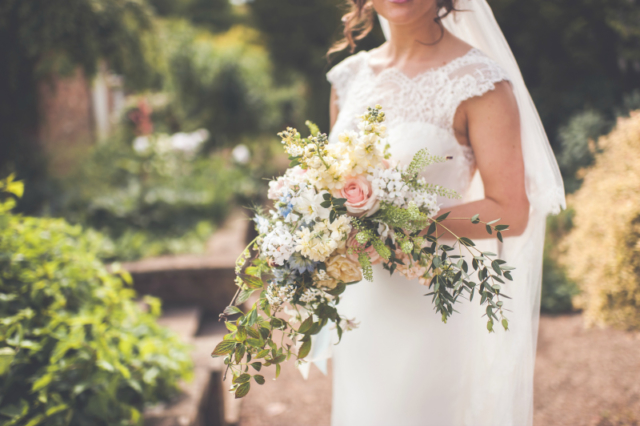 A natural pastel spring bride's bouquet using English country garden flowers. Sherbourne Park, Warwickshire. Wedding flowers by Tuckshop Flowers, Birmingham.
