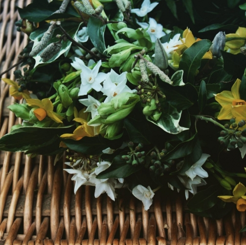 Natural, informal, seasonal funeral flowers for January. This informal wreath is contains ivy, scented narcissi, hazel catkins and green hellebores. By Tuckshop Flowers, Birmingham.