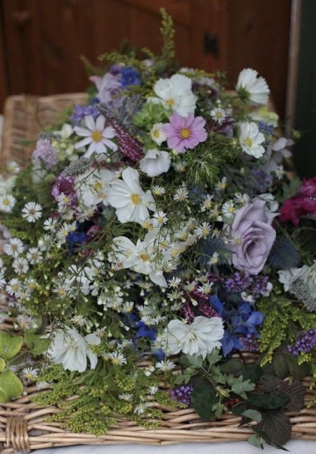 A natural wildflower style seasonal funeral sheaf for September. One of the many plastic foam free floral designs for funerals by Tuckshop Flowers Birmingham.