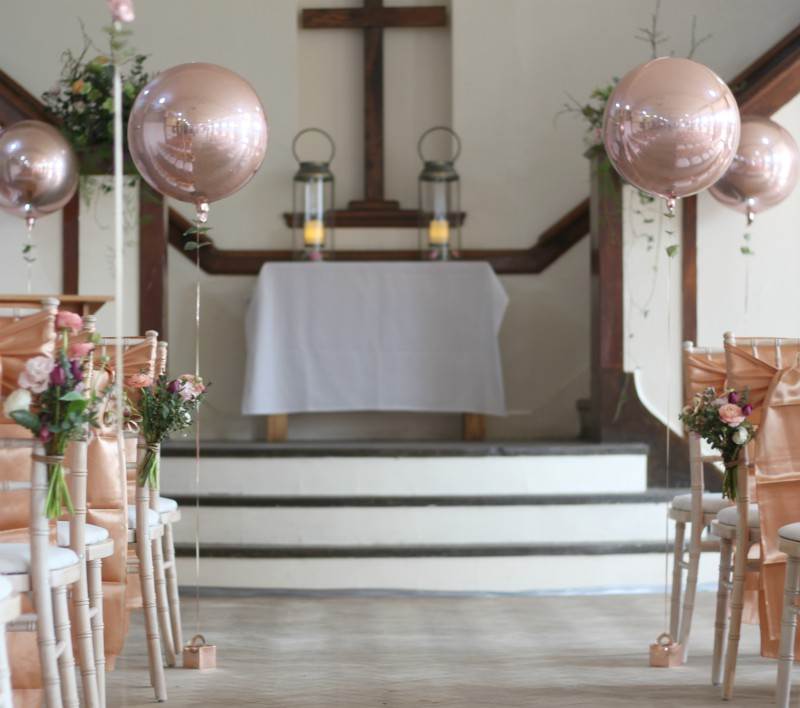natural wedding chair posies for a rose gold leafy wedding