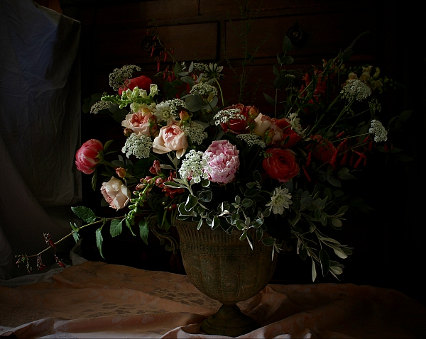 A Dutch masters opulent wedding urn of real summer roses, peonies and foxgloves, arranged and photographed by Tuckshop Flowers.