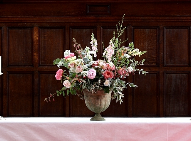 Wildflower style wedding arrangement for a Birmingham church wedding by Tuckshop Flowers.  Roses, peonies and foxgloves with other wildflower ingredients grown locally.