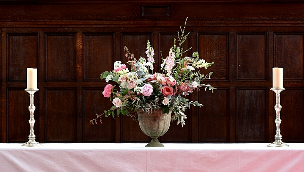 Church altar flowers for a June wedding with roses and peonies.