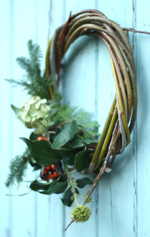 woven willow Christmas wreath with fresh foliage garland by Tuckshop Flowers, Birmingham. Available to order at Moseley Farmers Market in November or to buy in December.