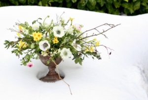 Wedding table centrepiece with seasonal spring flowers by Tuckshop Flowers Birmingham.