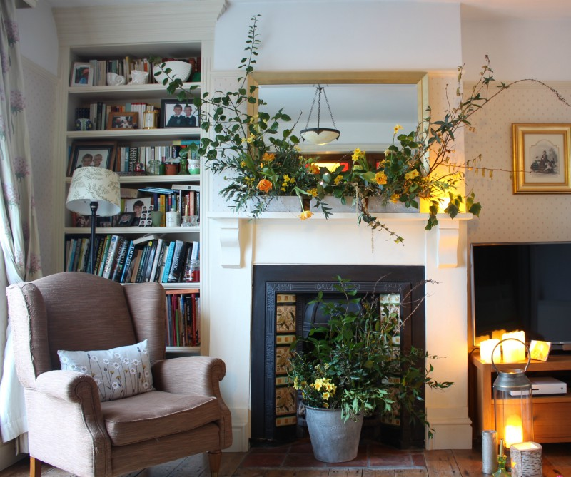 Wild and wonderful winter mantlepiece inspired by seasonal winter ingredients. Tuckshop Flowers, Birmingham