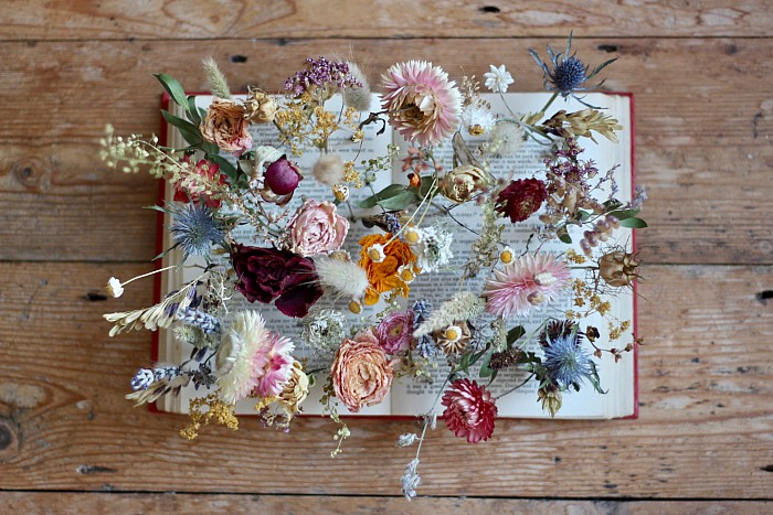 dried flower table centrepiece for a winter booklovers wedding by Tuckshop Flowers Birmingham