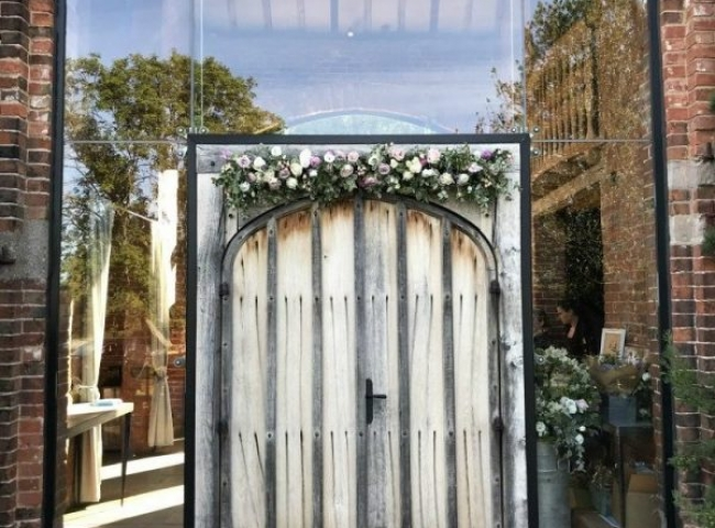 boho wedding flowers Shustoke Barns Warwickshire. Entrance door flowers by Tuckshop Flowers, Birmingham West Midlands.
