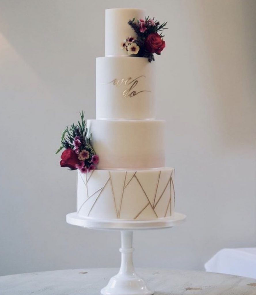 We Do wedding cake by Cotton and Crumbs. Flowers by Tuckshop Flowers, Birmingham