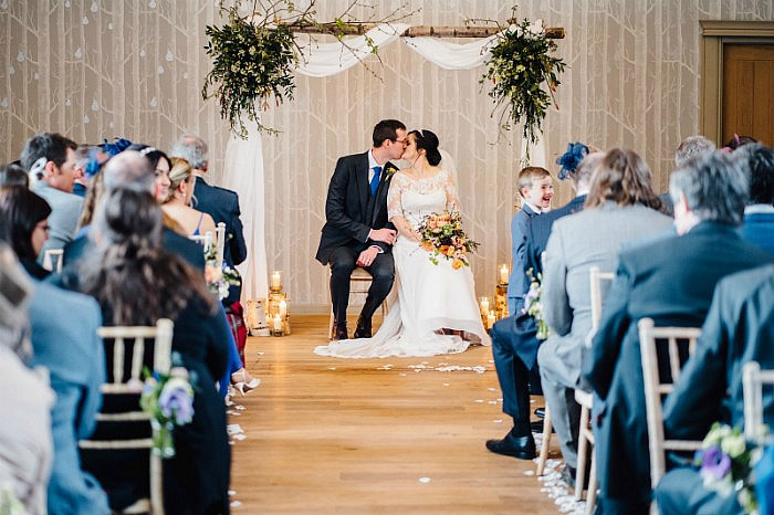 Silver birch wedding arch in the Birches ceremony room at Hampton Manor, Warwickshire