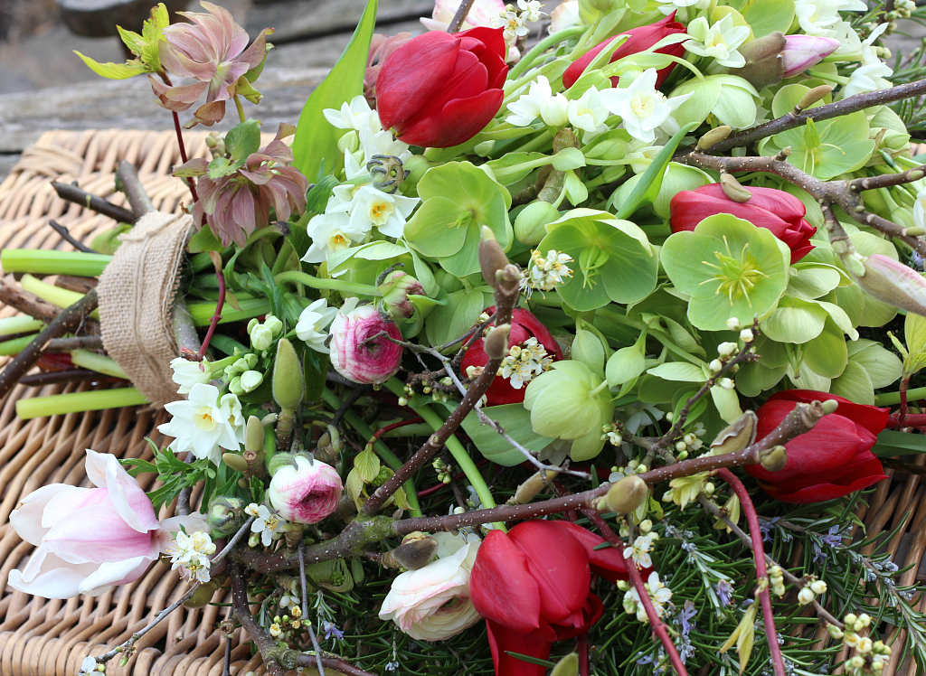 An alternative to traditional funeral flowers. A natural sheaf of British grown spring flowers by Tuckshop Flowers, Birmingham. For natural funeral flowers in Birmingham, West Midlands, Worcestershire and Warwickshire