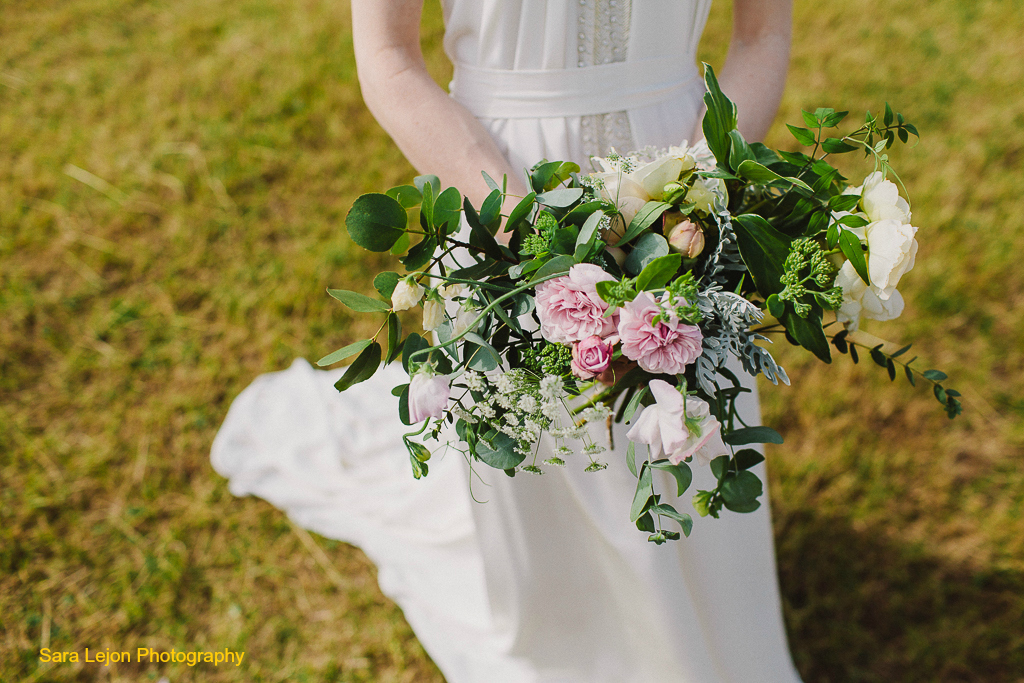 Natural, escaping woodland wedding inspired bride's bouquet by Tuckshop Flowers. Natural wildflower wedding florist serving West Midlands, Warwickshire and Worcestershire.