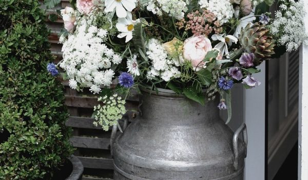 A rustic milk churn overflowing with natural English country wedding flowers welcomes guests to a Moxhull Hall wedding in July. Tuckshop Flowers can provide natural flowers for weddings throughout the West Midlands, Staffordshire, Warwickshire and Worcestershire.