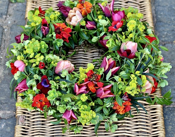 Foam free natural spring funeral wreath with colourful tulips, wallflowers, euphorbia and hellebores. Tuckshop Flowers, Birmingham