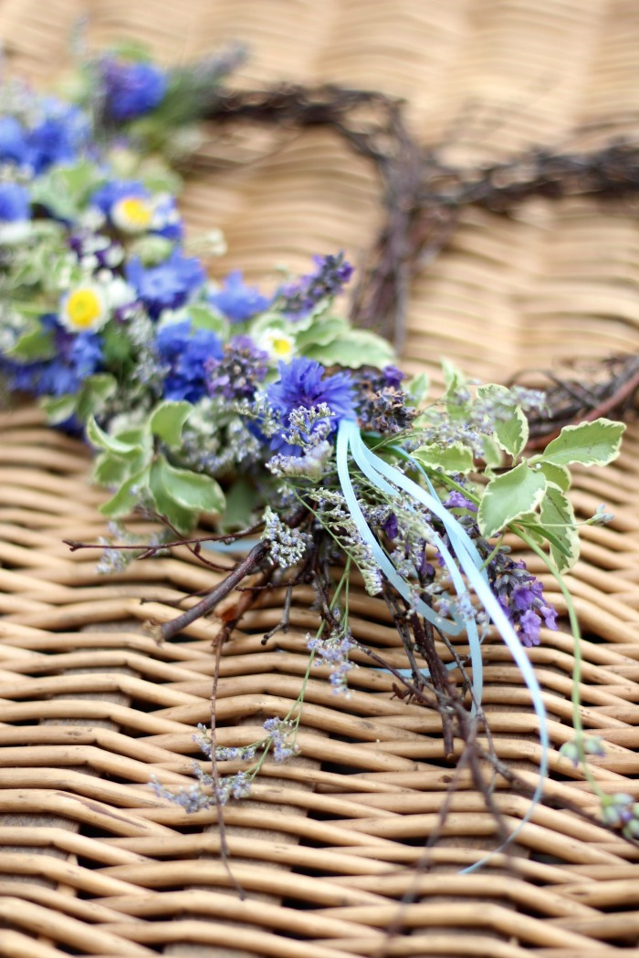 Wildflowers for funerals by Tuckshop Flowers, Birmingham. A seasonal silver birch heart with a garland of cornflowers, lavender and September flowers and foliage.
