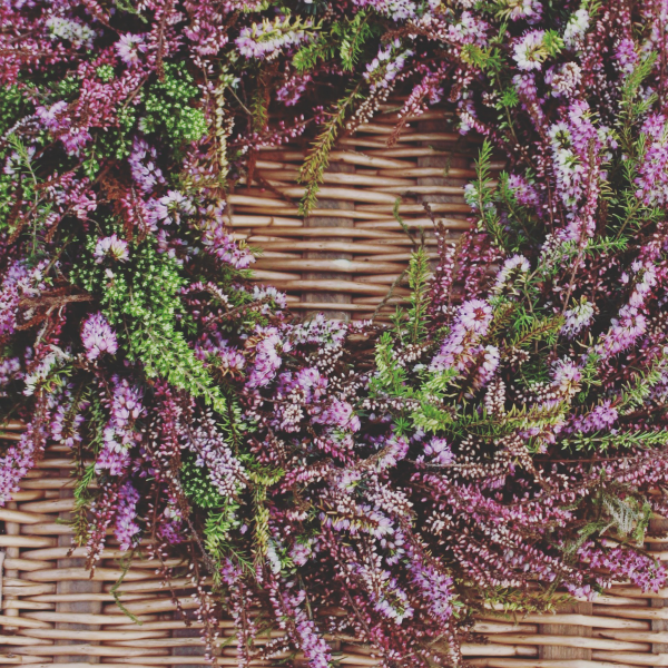 Natural heather wreath on a moss and wire base for a winter funeral. Bespoke natural funeral flowers by Tuckshop Flowers, Birmingham