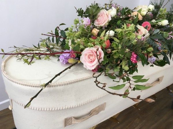 natural casket spray which can be deconstructed after the funeral into 6 tied bouquets