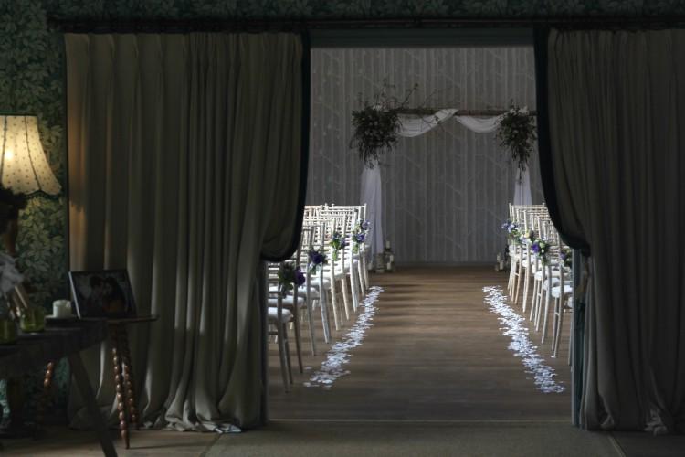 Natural woodland Wedding arch for a spring wedding at Hampton Manor, Warwickshire. Tuckshop Flowers, Birmingham