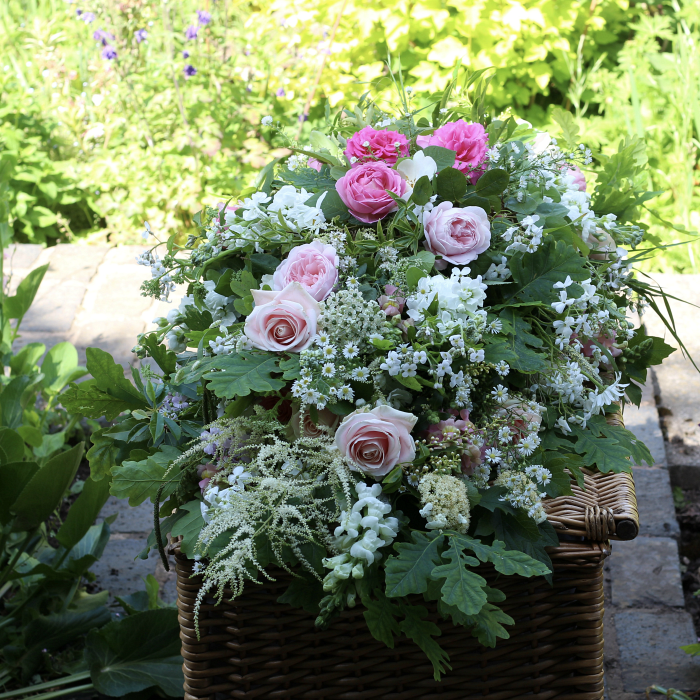 English country garden style funeral flowers.  Eco design without floral foam. This casket spray is made up of bouquets which can be separated and shared by friends and family.